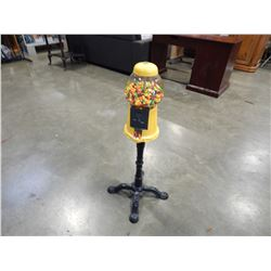 YELLOW METAL GUMBALL MACHINE W/ CAST IRON BASE AND CONTENTS