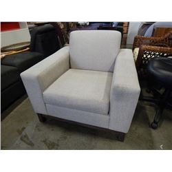 UPHOLSTERED BEIGE ARM CHAIR