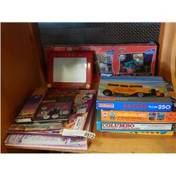 SHELF LOT OF VINTAGE TOYS: INCLUDING BARBIE, CARS, AND ETCH A SKETCH