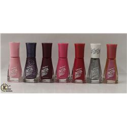 BAG OF ASSORTED COLOR SALLY HANSEN INSTA-DRI NAIL COLOR.
