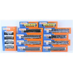 BOX OF ASSORTED ROCO MODEL TRAIN CARS. HO SCALE