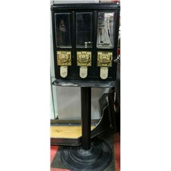 COIN OPERATED CANDY MACHINE.