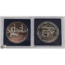 TWO CANADIAN SILVER DOLLAR COINS.