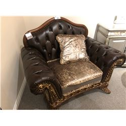 DARK BROWN LEATHER OVER SIZED LOUNGE CHAIR WITH WOOD TRIM AND THROW CUSHION.  RETAIL $4,580.00