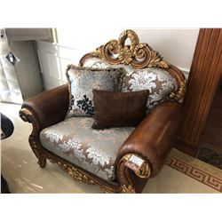 OVER SIZED LEATHER AND FLORAL PRINT LOUNGE CHAIR.  RETAIL $3,900.00