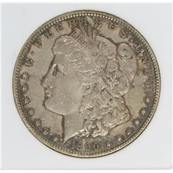 1890-CC TAILBAR MORGAN SILVER DOLLAR