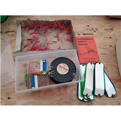 Box of Flashers, Lures, Fishing Line And Fishing Safety Manual