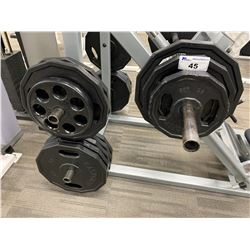 ASSORTED FREE WEIGHTS LOCATED ON VERTICAL LEG PRESS