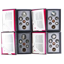 Lot (4) Canada Silver Double Dollar Coin Sets.