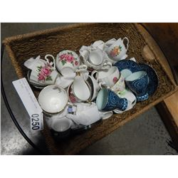 WICKER BASKET OF VARIOUS CHINA TEA CUPS