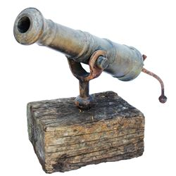 Early 19th-century American bronze swivel-mount cannon with iron tiller.