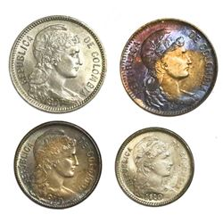 Lot of four Colombia copper-nickel papel moneda coins: 5 pesos, 1907AM and 1912-H; 2 pesos, 1910AM;