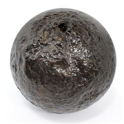 Medium-sized (five-pounder) iron cannonball, intact, ex-early 1700s wreck.