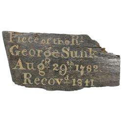 Wooden piece of the HMS Royal George (1782), with gold-colored writing on it dating the recovery to