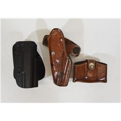 Two Pistol Holsters and One Mag Holster