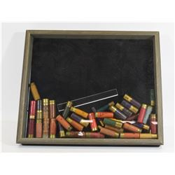 Display Case w/ Approximately 40 Assorted Rounds