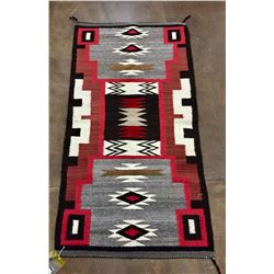 Navajo Storm Pattern Rug by Mary Manygoats