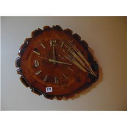Wooden tree slab clock with barley stocks
