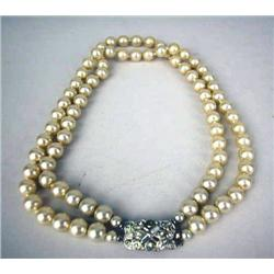 A VINTAGE COSTUME DOUBLE STRAND  PEARL NECKLACE WITH FAUX DIAMOND CLASP