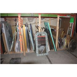 LARGE LOT OF ARTWORK UNDER PALLET RACKING
