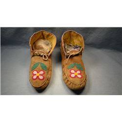 Nez Perce' moccasins, ankle high, partially beaded.