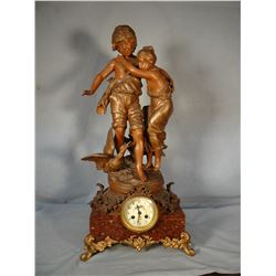 "Aug Moreau French figural clock, 24 "" h, boy and girl with goose, hand painted clock face"