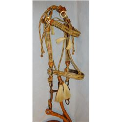 Hitched horsehair bridle with leather reins, possibly Deer Lodge