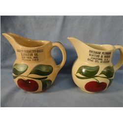 "(2) Watt Ware advertising pitchers, 6"" each, Harvey, ND Farmers Union Elevator; Goodman Plumbing, Ja"