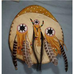 """Blackfeet shield -two feathers, 17"""" w"""