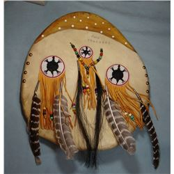 "Blackfeet shield -two feathers, 17"" w"