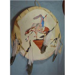 "Crow rawhide shield, I. Lion Shows, 30"" w"