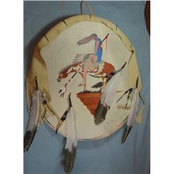 "Crow rawhide shield, I. Lion Shows, 30"" w"