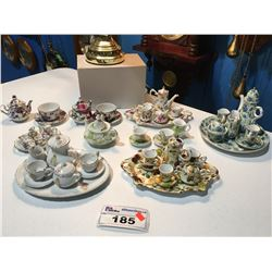 SHELF LOT OF ASSTED MINIATURE TEAPOTS, CUPS/SAUCERS/CREAMERS & SUGAR
