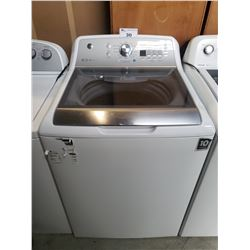 GE WASHER MODEL: GTW680BMM0WS DENT ON TOP FRONT RIGHT CORNER