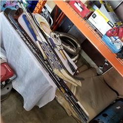 LOT OF HOCKEY STICKS AND SPORTS GEAR