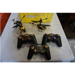 2 RC HELICOPTERS IN YELLOW CRATE