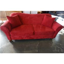 RED UPHOLSTERED SOFA BED