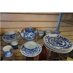 LOT OF BLUE AND WHITE EASTERN DISHES AND TEAPOT