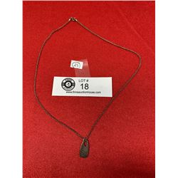 An Engraved Sterling Silver Pendant and Chain. Marked Italy 925