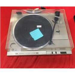 Vintage Hitachi Record Player with A New Belt in Good Working Order. Plexiglass Cover Has a Crack