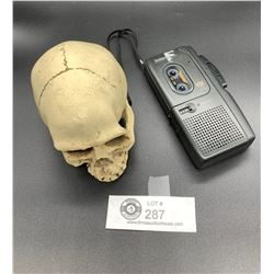 A Neat Looking Skull and a Mini Cassette Tape Recorder