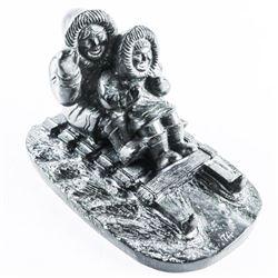 Eskimos Sledding Sculpture
