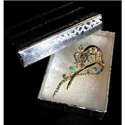 Elegant designer brooch with colorful rhinestones