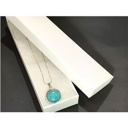 Contemporary silver necklace with turquoise rhinestone.