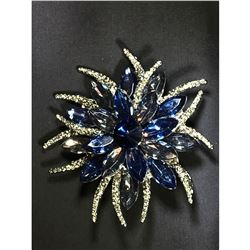 Contemporary blue rhinestoneflower motif brooch.