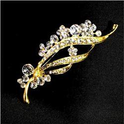 Contemporary designer brooch with rhinestones.