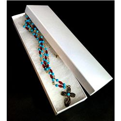 Designer beaded necklace with cross.