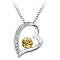 Austrian Crystal with Swarovski Elements - Heart w/ dark yellow gem inside