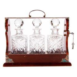 A locking Tantalus decanter set.