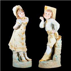 Pair of continental porcelain children.